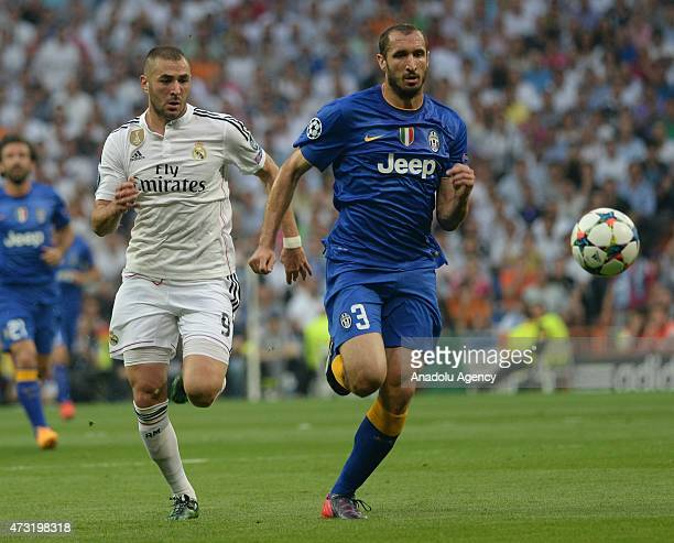 Karim Benzema of Read Madrid vies with Giorgio Chiellini of Juventus during the UEFA Champions League semifinal second leg soccer match between Real...