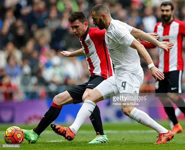 Karim Benzema of Real Madrid and Aymeric Laporte of Athletic Bilbao compete for the ball during the La Liga match between Real Madrid CF and Athletic...