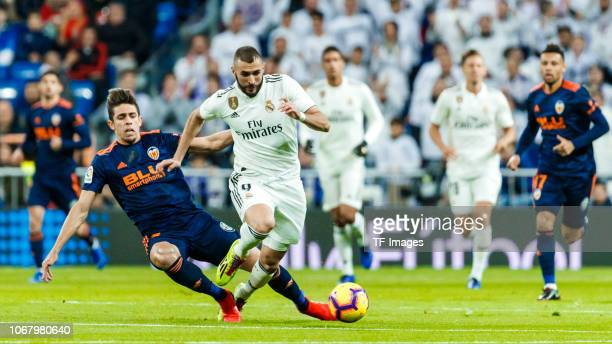 Karim benzema of Real Madrid and Gabriel Paulista of Valencia battle for the ball during the La Liga match between Real Madrid v Valencia at the...