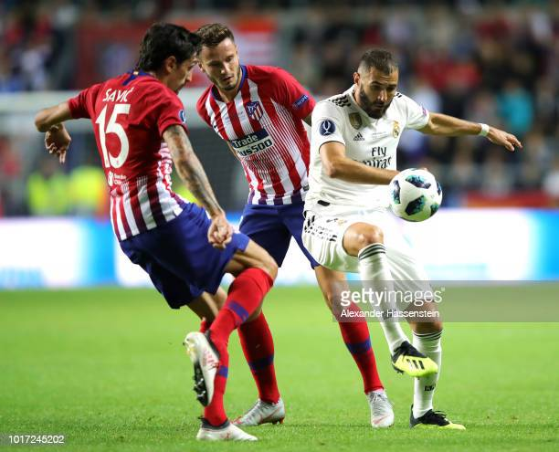Karim Benzema of Real Madrid and Saul Niguez of Atletico Madrid in action during the UEFA Super Cup between Real Madrid and Atletico Madrid at...