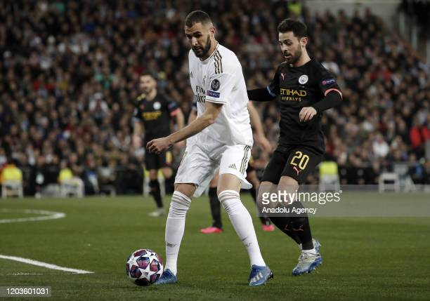 Karim Benzema of Real Madrid argues with Bernardo Silva of Manchester City during the UEFA Champions League round of 16 first leg soccer match...