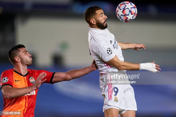 Karim Benzema of Real Madrid battle for the ball with Davit Khocholava of Shakhtar Donetsk during the UEFA Champions League Group B stage match...