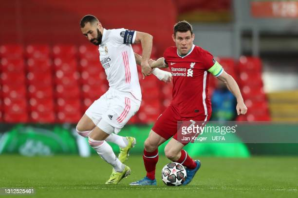 Karim Benzema of Real Madrid battles for possession with James Milner of Liverpool during the UEFA Champions League Quarter Final Second Leg match...