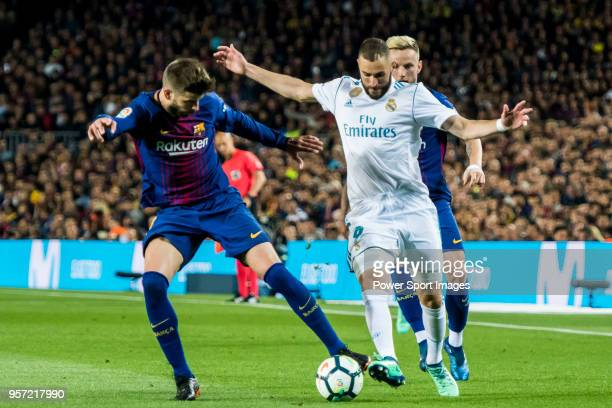 Karim Benzema of Real Madrid battles for the ball with Gerard Pique Bernabeu of FC Barcelona during the La Liga match between Barcelona and Real...