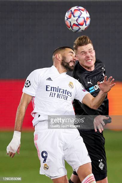Karim Benzema of Real Madrid battles for the ball with Oscar Wendt of Borussia Moenchengladbach during the UEFA Champions League Group B stage match...