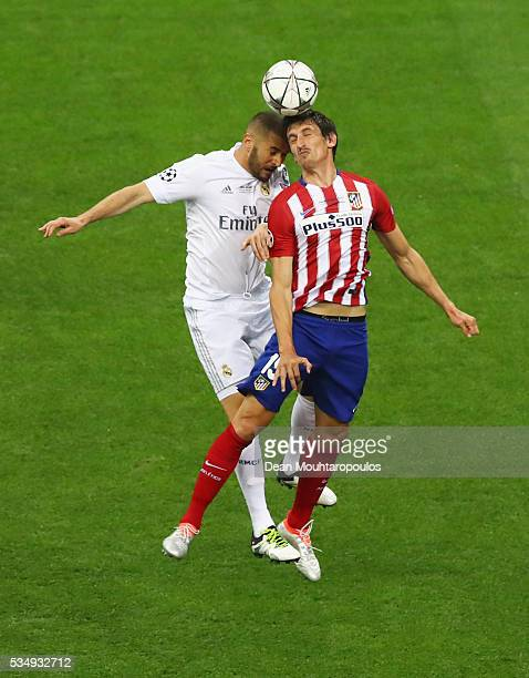 Karim Benzema of Real Madrid battles for the ball with Stefan Savic of Atletico Madrid during the UEFA Champions League Final match between Real...