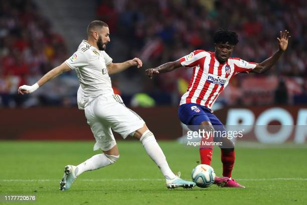 Karim Benzema of Real Madrid battles for the ball with Thomas Partey of Atletico Madrid during the Liga match between Club Atletico de Madrid and...