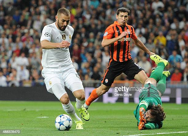 Karim Benzema of Real Madrid beats Andriy Pyatov of Shakhtar Donetsk but does not socre during the UEFA Champions League Group A match between Real...
