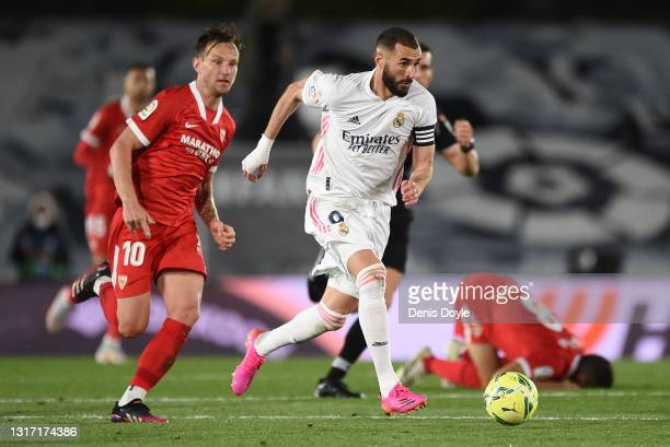 Karim Benzema of Real Madrid breaks away from Ivan Rakitic of Sevilla FC during the La Liga Santander match between Real Madrid and Sevilla FC at...
