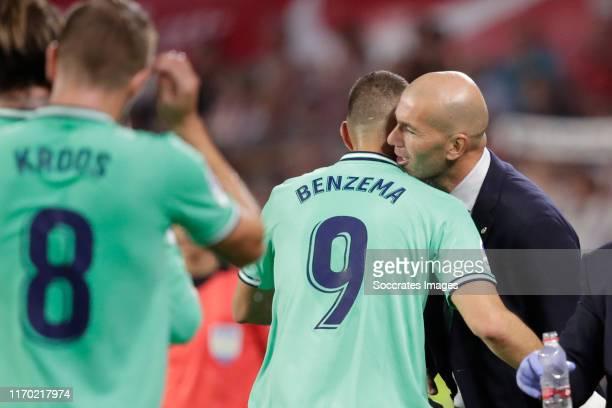 Karim Benzema of Real Madrid Celebrates 01 with coach Zinedine Zidane of Real Madrid during the La Liga Santander match between Sevilla v Real Madrid...
