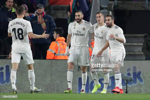Karim Benzema of Real Madrid Celebrates 01 with Marcos Llorente of Real Madrid Lucas Vazquez of Real Madrid Dani Carvajal of Real Madrid during the...