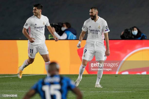 Karim Benzema of Real Madrid Celebrates 1-0 with Marco Asensio of Real Madrid during the UEFA Champions League match between Real Madrid v...