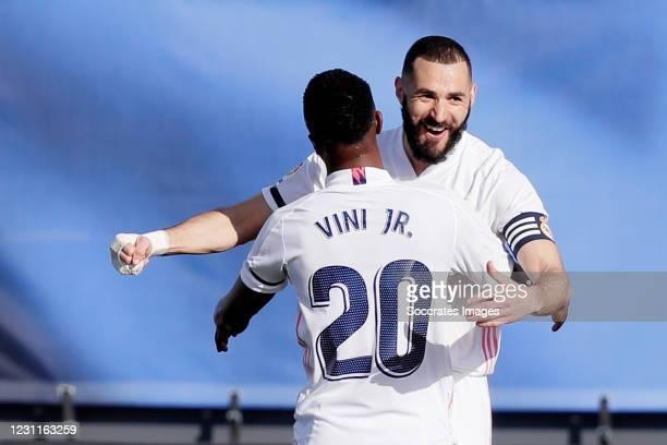 Karim Benzema of Real Madrid Celebrates 1-0 with Vinicius Junior of Real Madrid during the La Liga Santander match between Real Madrid v Valencia at...