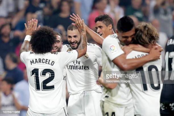 Karim Benzema of Real Madrid celebrates 31 with Marcelo of Real Madrid Raphael Varane of Real Madrid during the La Liga Santander match between Real...