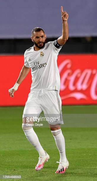 Karim Benzema of Real Madrid celebrates after he scores his team's opening goal by penalty kick during the Liga match between Real Madrid CF and...