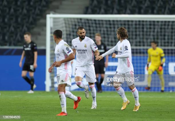 Karim Benzema of Real Madrid celebrates after he scores his team's first goal during the UEFA Champions League Group B stage match between Borussia...