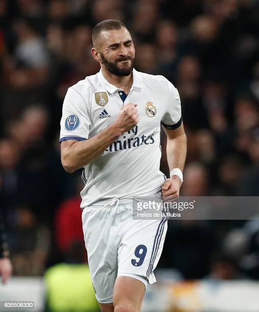 Karim Benzema of Real Madrid celebrates after scoring during the UEFA Champions League Round of 16 first leg match between Real Madrid CF and SSC...