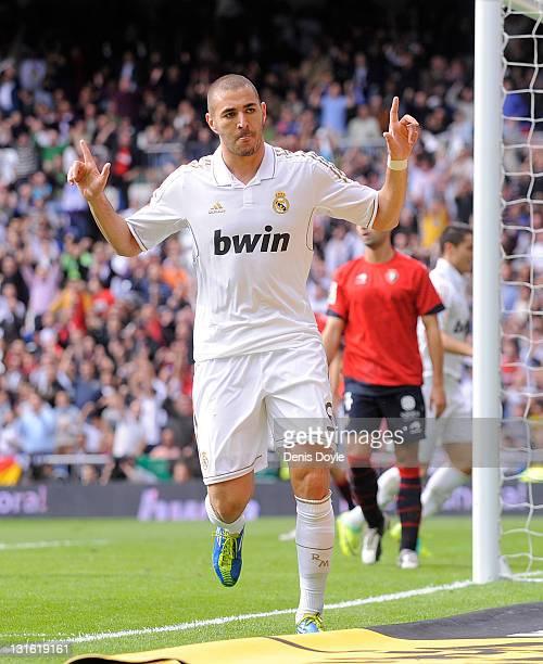 Karim Benzema of Real Madrid celebrates after scoring his first goal during the La Liga match between Real Madrid and Osasuna at Estadio Santiago...