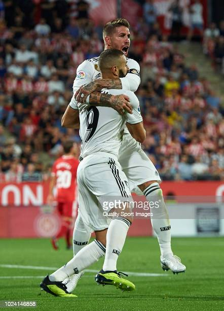 Karim Benzema of Real Madrid celebrates after scoring his sides first goal second goal with his teammate Sergio Ramos during the La Liga match...