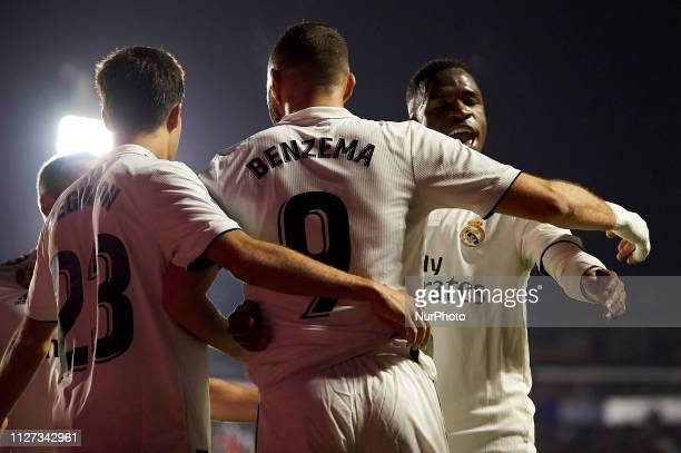 Karim Benzema of Real Madrid celebrates after scoring his sides first goal whit Vinicius Junior during the week 25 of La Liga match between Levante...