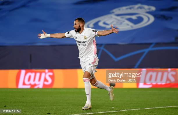 Karim Benzema of Real Madrid celebrates after scoring his sides first goal during the UEFA Champions League Group B stage match between Real Madrid...