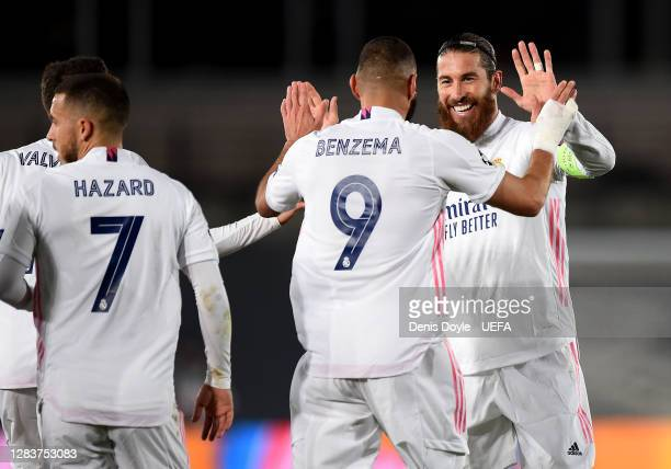 Karim Benzema of Real Madrid celebrates after scoring his sides first goal with Sergio Ramos of Real Madrid during the UEFA Champions League Group B...