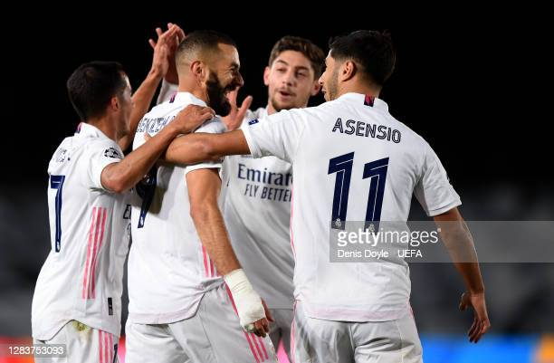 Karim Benzema of Real Madrid celebrates after scoring his sides first goal with Marco Asensio of Real Madrid during the UEFA Champions League Group B...
