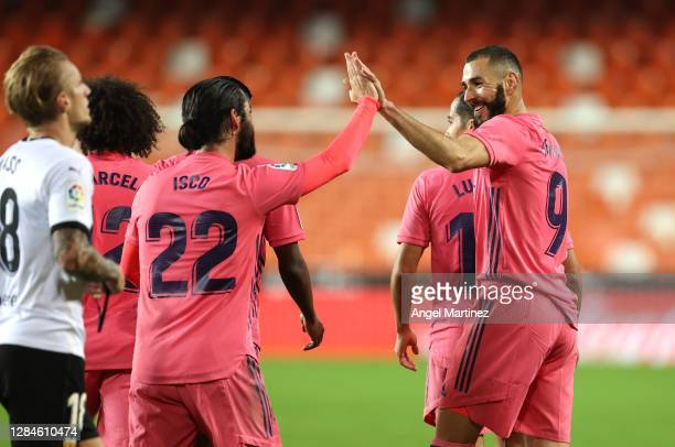 Karim Benzema of Real Madrid celebrates after scoring his sides first goal with Isco during the La Liga Santander match between Valencia CF and Real...