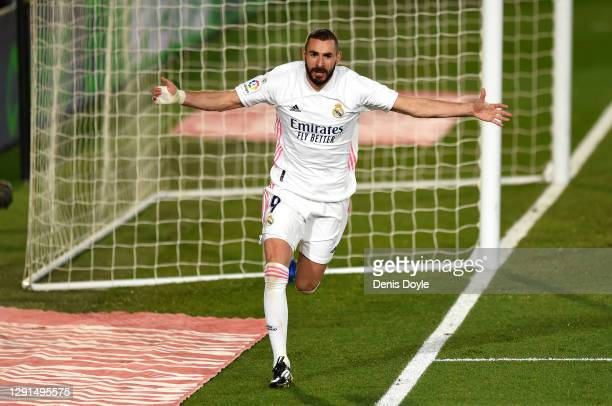 Karim Benzema of Real Madrid celebrates after scoring his sides second goal during the La Liga Santander match between Real Madrid and Athletic Club...