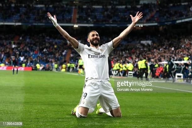 Karim Benzema of Real Madrid celebrates after scoring his sides third goal during the La Liga match between Real Madrid CF and SD Huesca at Estadio...