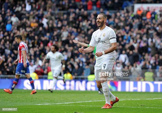 Karim Benzema of Real Madrid celebrates after scoring his team's 5th goal during the La Liga match between Real Madrid CF and Sporting Gijon at...