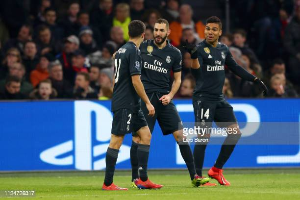 Karim Benzema of Real Madrid celebrates after scoring his team's first goal with Sergio Reguilon of Real Madrid and Casemiro of Real Madrid during...