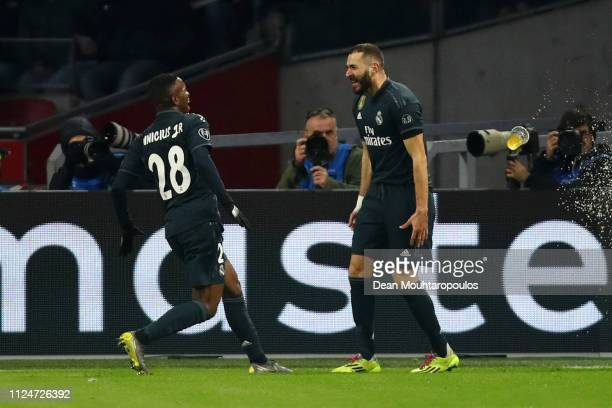 Karim Benzema of Real Madrid celebrates after scoring his team's first goal with Vinicius Junior of Real Madrid during the UEFA Champions League...