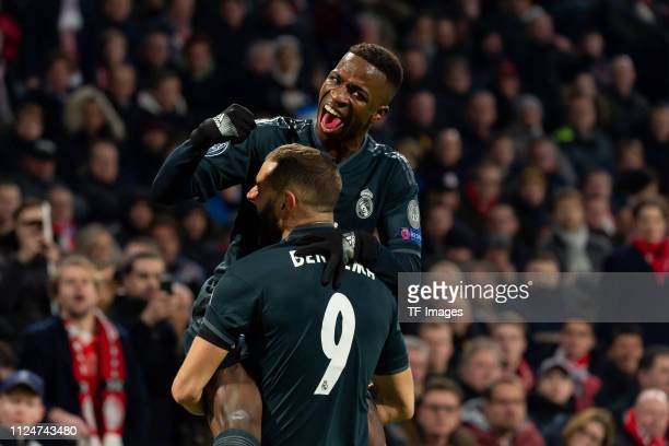 Karim Benzema of Real Madrid celebrates after scoring his team's first goal with Vinicius Junior of Real Madridduring to the UEFA Champions League...