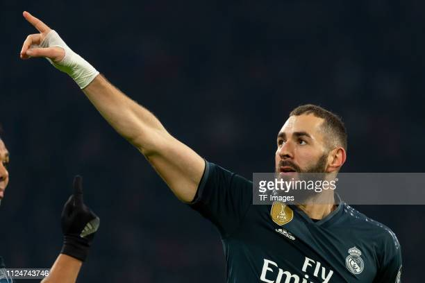 Karim Benzema of Real Madrid celebrates after scoring his team's first goal during to the UEFA Champions League Round of 16 First Leg match between...
