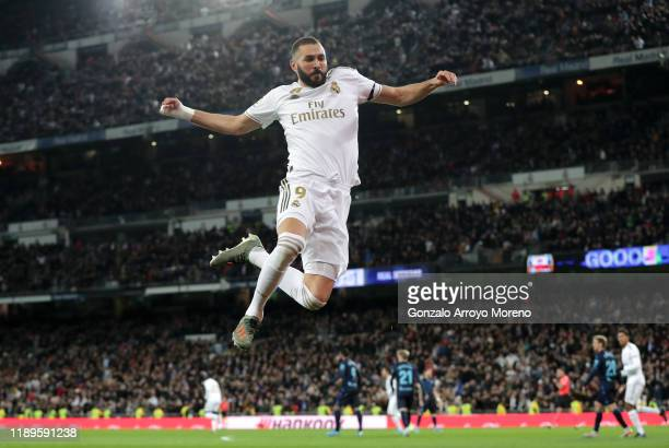 Karim Benzema of Real Madrid celebrates after scoring his team's first goal during the La Liga match between Real Madrid CF and Real Sociedad at...