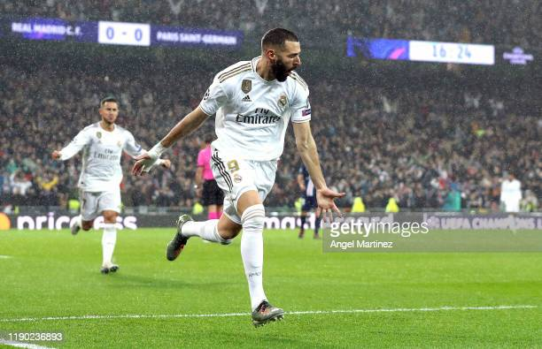 Karim Benzema of Real Madrid celebrates after scoring his team's first goal during the UEFA Champions League group A match between Real Madrid and...