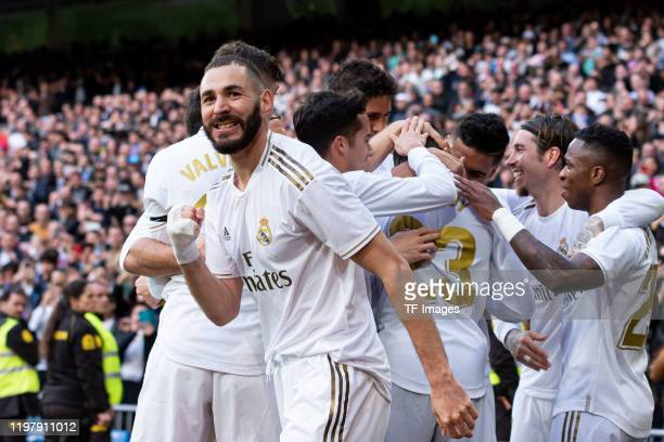 Karim Benzema of Real Madrid celebrates after scoring his team's first goal with team mates during the Liga match between Real Madrid CF and Club...