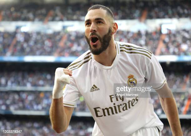 Karim Benzema of Real Madrid celebrates after scoring his team's first goal during the La Liga match between Real Madrid CF and Club Atletico de...