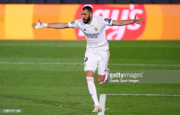 Karim Benzema of Real Madrid celebrates after scoring his team's first goal during the UEFA Champions League Group B stage match between Real Madrid...
