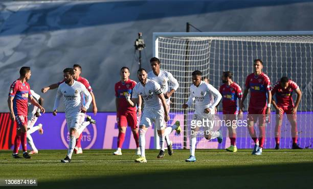 Karim Benzema of Real Madrid celebrates after scoring his team's first goal during the La Liga Santander match between Real Madrid and Elche CF at...