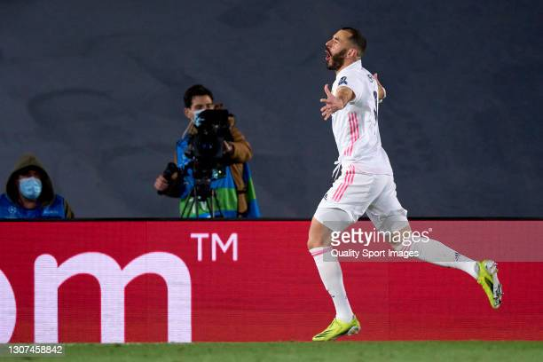 Karim Benzema of Real Madrid celebrates after scoring his team's first goal during the UEFA Champions League Round of 16 match between Real Madrid...