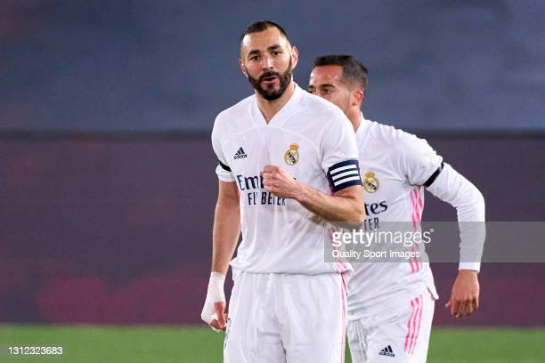 Karim Benzema of Real Madrid celebrates after scoring his team's first goal during the La Liga Santander match between Real Madrid and FC Barcelona...