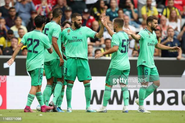 Karim Benzema of Real Madrid celebrates after scoring his team's second goal with members of his team during the Audi cup 2019 3rd place match...