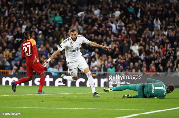 Karim Benzema of Real Madrid celebrates after scoring his team's fourth goal during the UEFA Champions League group A match between Real Madrid and...
