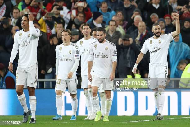 Karim Benzema of Real Madrid celebrates after scoring his team's second goal during the UEFA Champions League group A match between Real Madrid and...