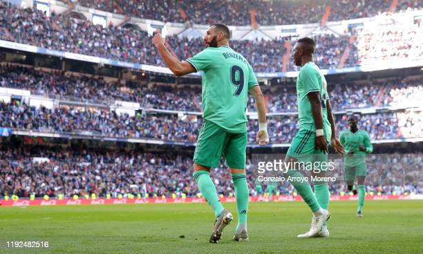 Karim Benzema of Real Madrid celebrates after scoring his team's second goal with Vinicius Junior of Real Madrid during the La Liga match between...