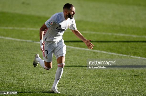 Karim Benzema of Real Madrid celebrates after scoring his team's second goal with his team during the La Liga Santander match between Levante UD and...