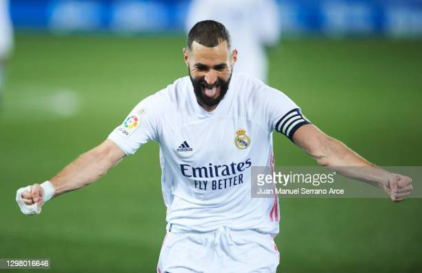 Karim Benzema of Real Madrid celebrates after scoring his team's second goal during the La Liga Santander match between Deportivo Alavés and Real...