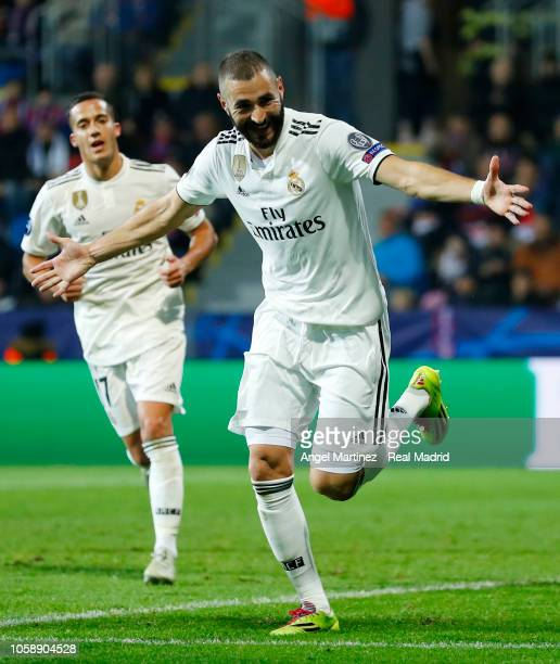 Karim Benzema of Real Madrid celebrates after scoring his team's third goal during the Group G match of the UEFA Champions League between Viktoria...